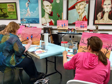 Students at a paint-and-wine evening