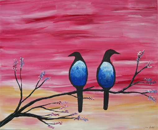 Two blue birds on branch