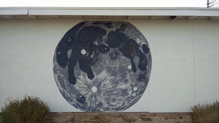 mural of moon on garage wall