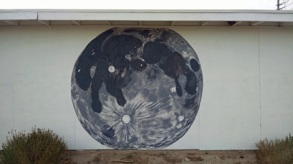 mural of moon on garage wall