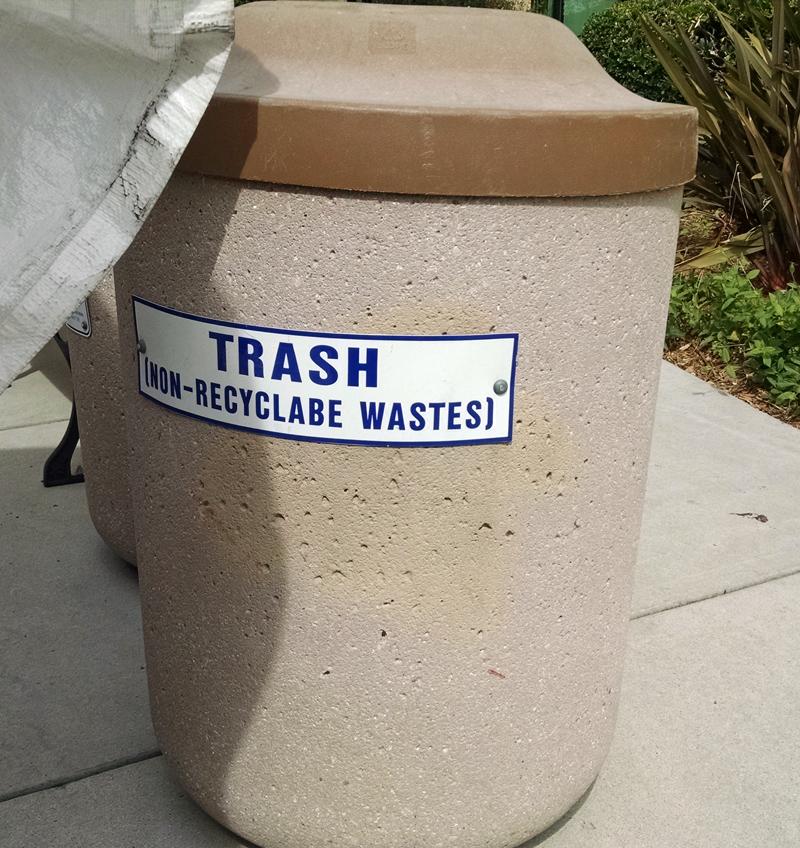 Misspelled trash can sign