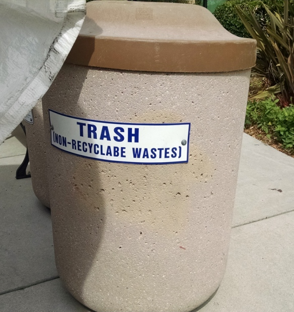 Misspelled trash can sign