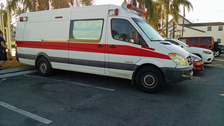 Ambulance squeezed into compact parking space