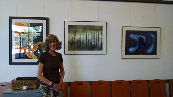 Jan P. Wright with paintings