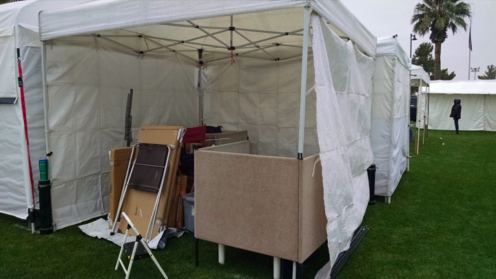 partially set up booth, with rain