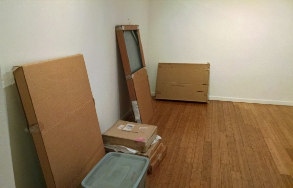 boxes of artwork in a bare room