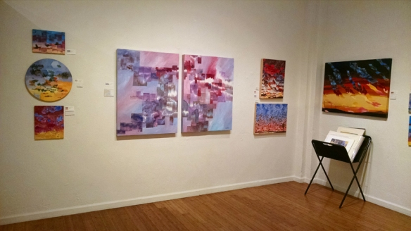 Mixed media paintings in a gallery