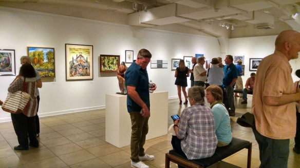 Art reception with crowd